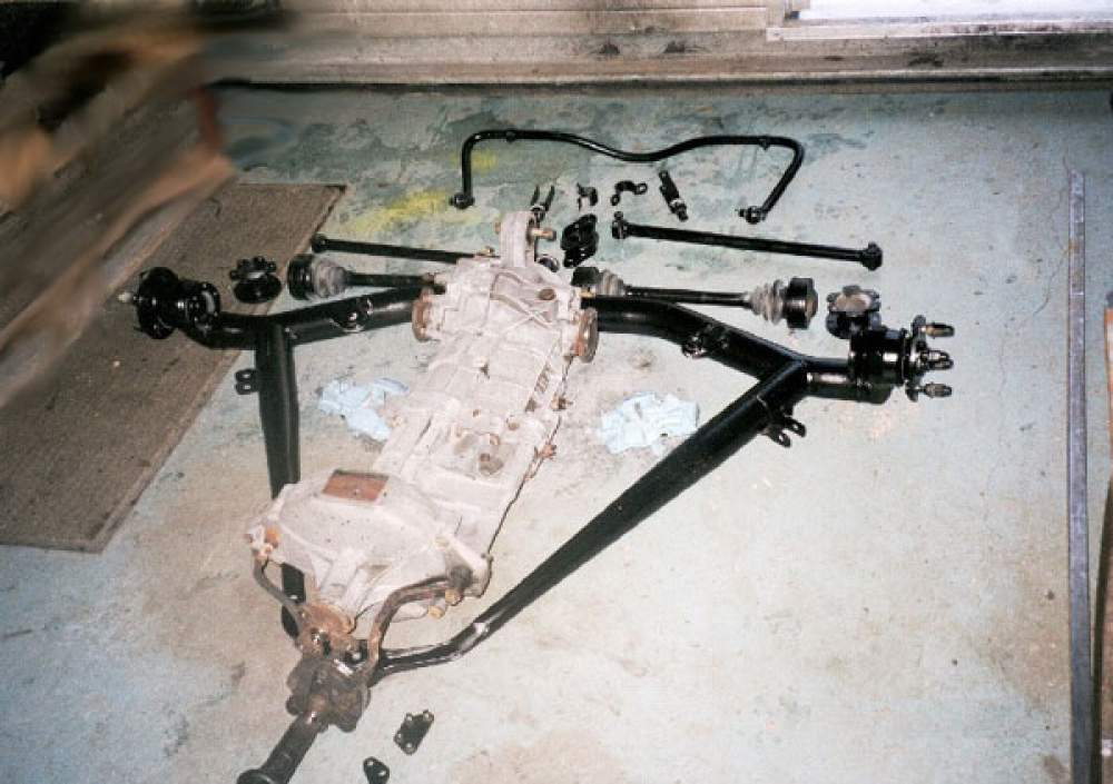 Gearbox unit and rear suspension